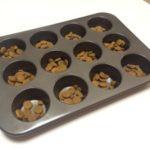 Use a cupcake tin to stop your dog inhaling food